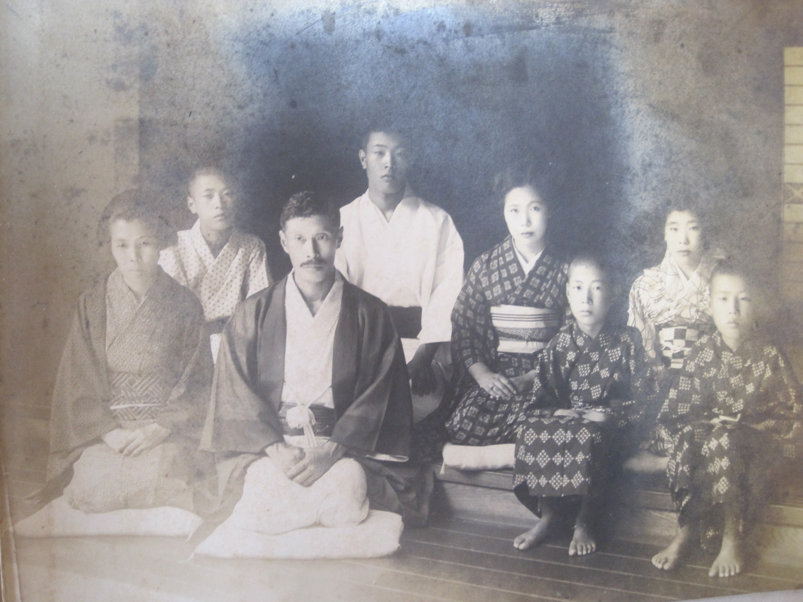 Their father is in white, and the tallest. He is second from the left, in back